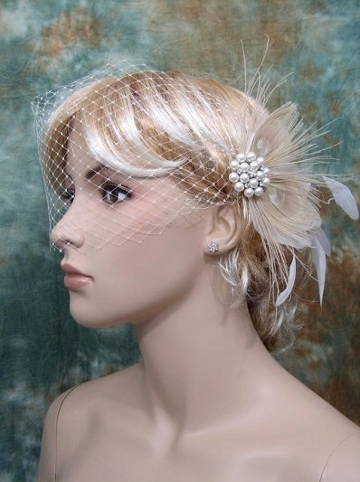 Ivory blusher birdcage veil with peacock feather fascinator