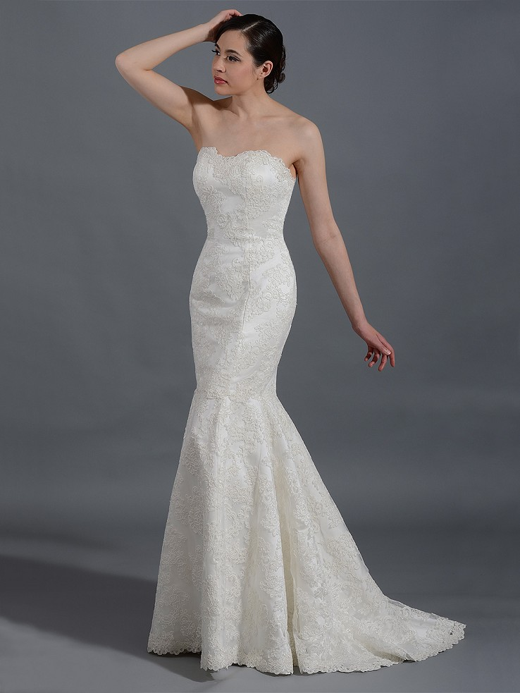 Ivory strapless lace wedding dress with re-embroidered lace
